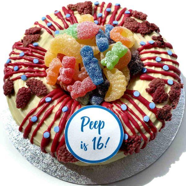 Giant raspberry ripple birthday doughnut